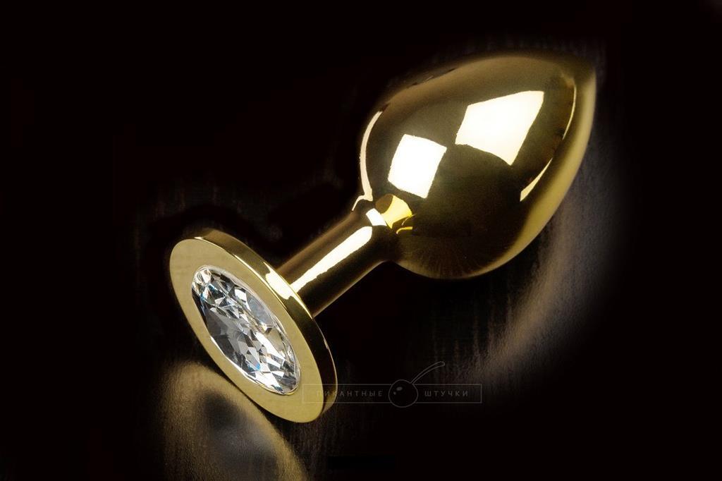 Большая золотая анальная пробка с закругленным кончиком и прозрачным кристаллом - 9 см.