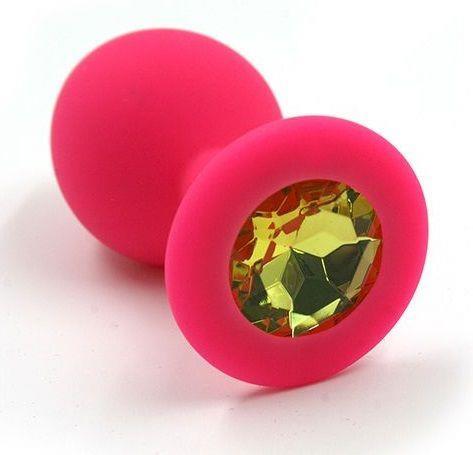 Розовая силиконовая анальная пробка с жёлтым кристаллом - 7 см.