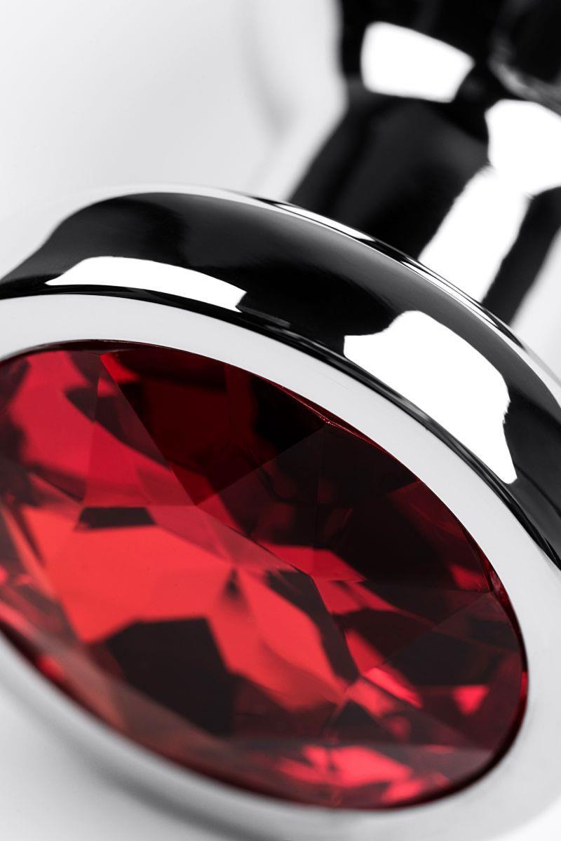Серебристая удлиненная коническая анальная пробка с красным кристаллом (10 см)