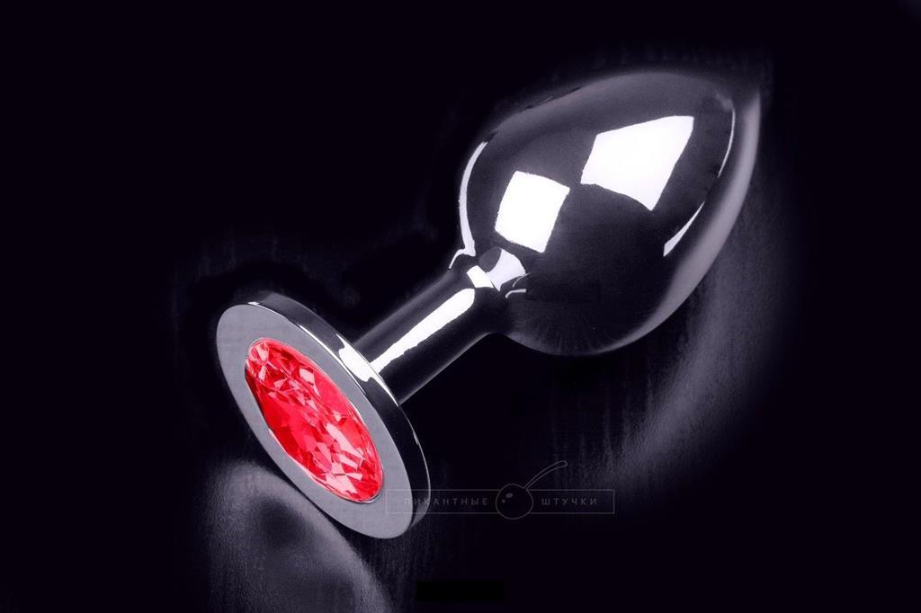 Большая серебристая анальная пробка с круглым кончиком и красным кристаллом - 9 см.